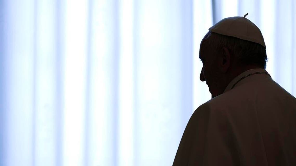 Pope Francis is silhouetted against the window as he meets Tuilaepa Aiono Sailele Malielegaoi, Prime Minister of Samoa, during a private audience at the Vatican Thursday, Dec. 3, 2015. (Vincenzo Pinto/Pool photo via AP)
