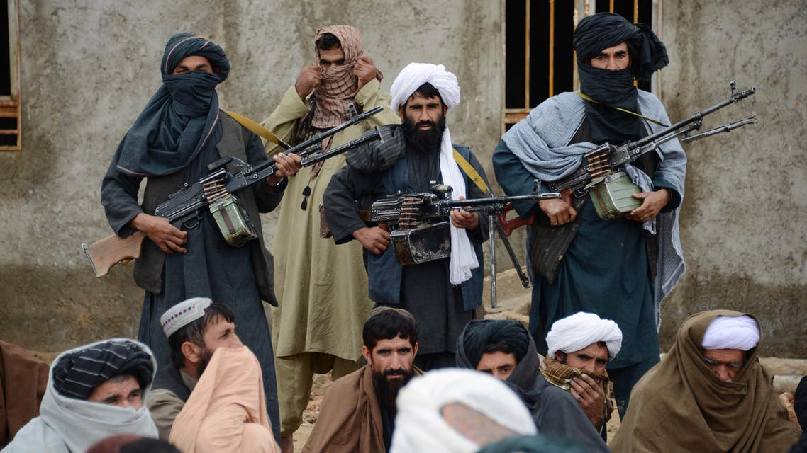 In this Tuesday, Nov. 3, 2015 photo, Afghan Taliban fighters listen to Mullah Mohammed Rasool, unseen, the newly-elected leader of a breakaway faction of the Taliban, in Farah province, Afghanistan. (AP