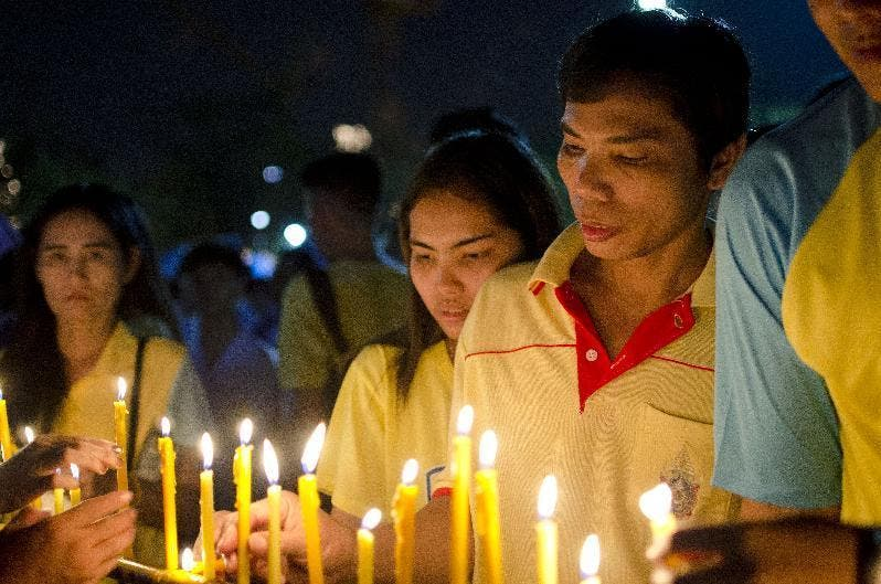 ell-wishers light candles for Thailand's King Bhumibol Adulyadej to mark his 88th birthday in Bangkok, Thailand