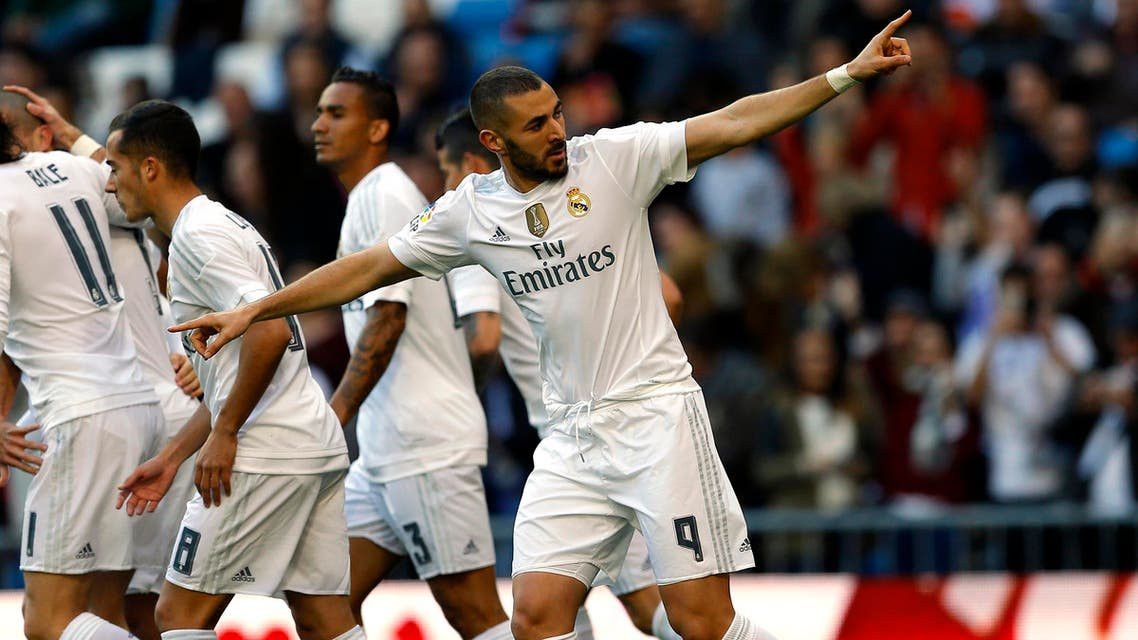 Real Madrid's Karim Benzema, right, celebrates with teammates after scoring the opening goal against Getafe during the Spanish La Liga soccer match between Real Madrid and Getafe at the Santiago Bernabeu stadium in Madrid, Saturday, Dec. 5, 2015. (AP