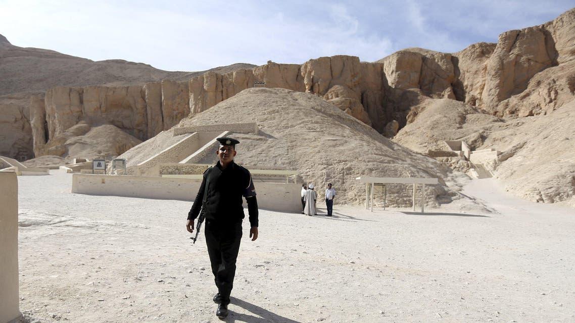 A policeman walks in front of the Valley of the Kings in Luxor, Egypt, November 28, 2015. Chances are high that the tomb of Ancient Egypt's boy-king Tutankhamun has passages to a hidden chamber, which may be the last resting place of the lost Queen Nefertiti, experts said on Saturday. REUTERS/Mohamed Abd El Ghany