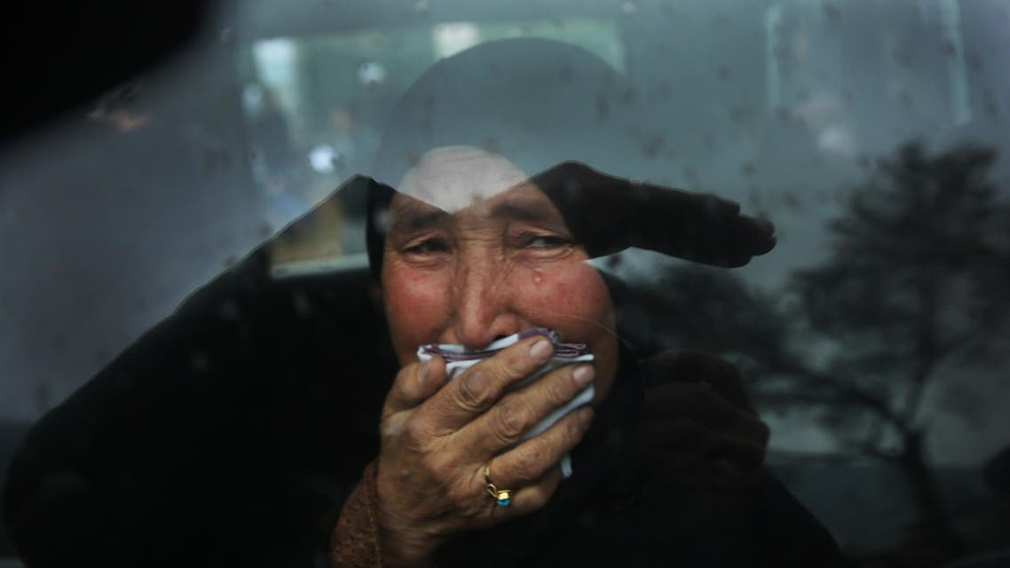 A Hazara tribeswoman cries in a car as thousands march through the Afghan capital of Kabul on Wednesday, Nov. 11, 2015, carrying the coffins of seven ethnic Hazaras who were allegedly killed by the Taliban and calling for a new government that can ensure security in the country. (AP Photos/Massoud Hossaini)