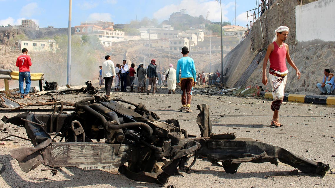 Yemenis inspect the scene of a car bomb attack that killed a Yemeni senior official in the southern port city of Aden, Yemen, Sunday, Dec. 6, 2015. (AP)