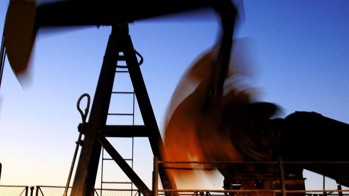 In this Nov. 13, 2009 file photo, an oil pump works in the Persian Gulf desert field of Sakhir, Bahrain. Oil prices rose above $82 a barrel Wednesday, March 17, 2010, after a report showed U.S. crude inventories grew less than expected last week and OPEC decided to keep its output targets unchanged. (AP