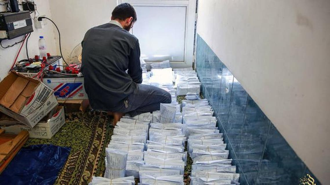 A photo from an ISIS website showed a member sorting envelopes of zakat (donations) collected from the rich to be distributed to the poor during the Muslim holy month of Ramadan in Mosul. (AP)