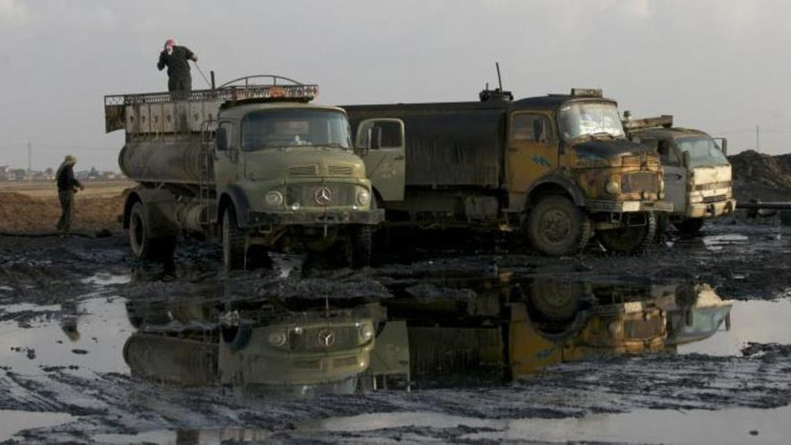A man stands on a truck near oil fields in Syria's northeastern Qamshli province. (File photo Reuters)