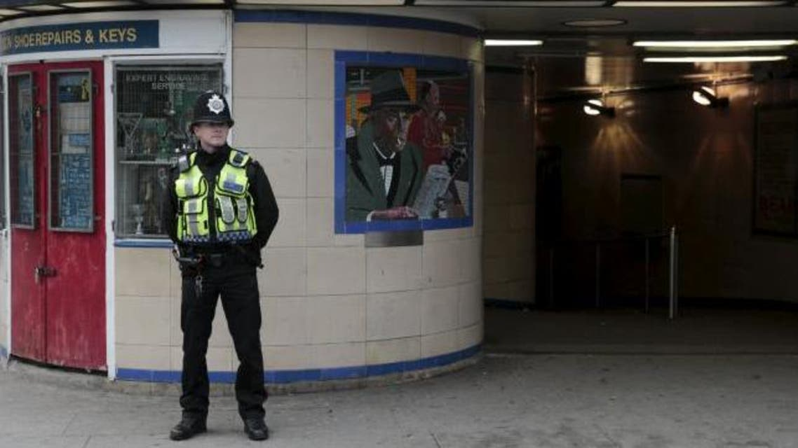 A police officer patrols outside Leytonstone Underground station in east London. (Reuters)