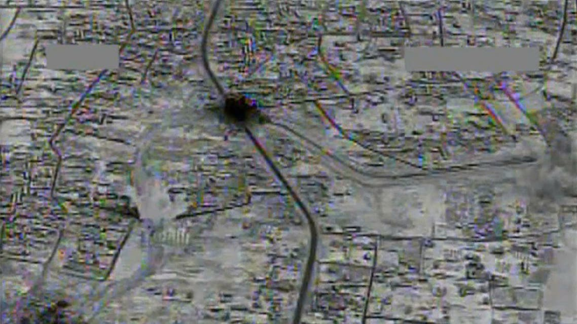 This image made from gun-camera video taken on July 4, 2015 and released by United States Central Command shows an airstrike on a main road and transit route near the Islamic State group-held Raqqa, Syria. After billions of dollars spent and more than 10,000 extremist fighters killed, the Islamic State group is fundamentally no weaker than it was when the U.S.-led bombing campaign began a year ago, American intelligence agencies have concluded