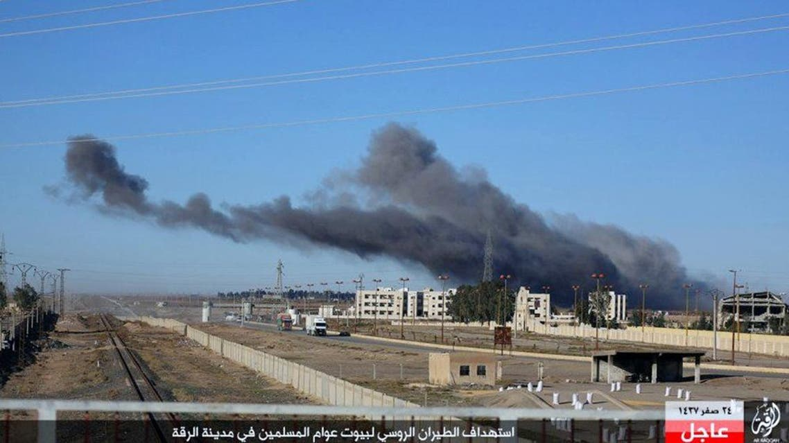 """This image posted online Sunday, Dec. 6, 2015, by supporters of the Islamic State militant group on an anonymous photo sharing website, shows smoke rising in the aftermath of an airstrike that targeted areas in Raqqa, Syria. The photo bears the watermark of Islamic State media releases and is consistent with other AP reporting. The Arabic caption on the photo reads, """"Russian warplanes target homes of Muslims in Raqqa."""" (militant photo via AP)"""