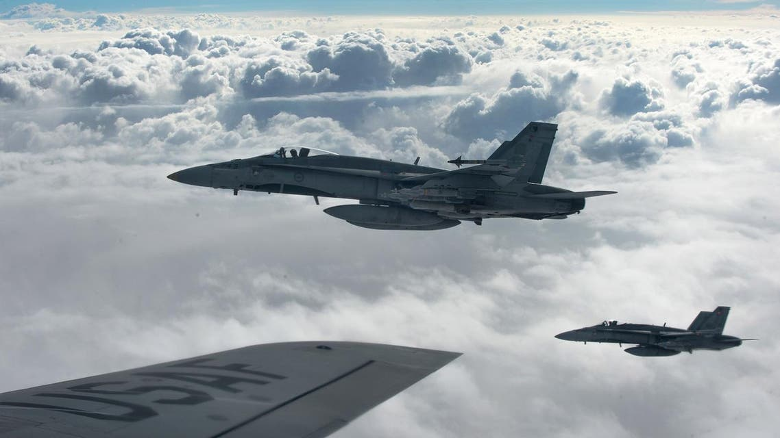 Royal Canadian Air Force CF-18 Hornets depart after refueling with a KC-135 Stratotanker assigned to the 340th Expeditionary Air Refueling Squadron over Iraq October 30, 2014. (Reuters)