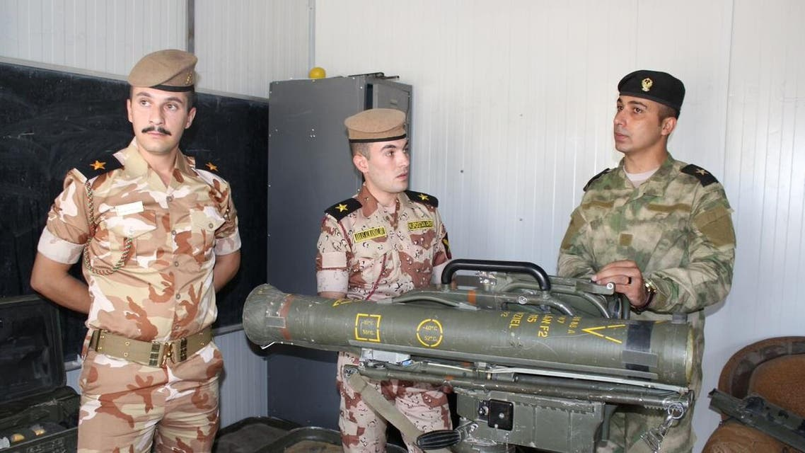 Kurdish Peshmerga fighters train on a German MILAN anti-tank missile. (Photo: Florian Neuhof)