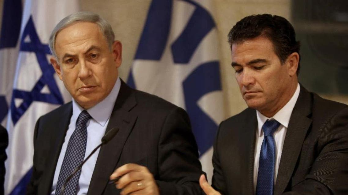 A picture taken at the Israeli foreign ministry on October 15, 2015, shows Prime Minister Benjamin Netanyahu (L) sitting next to newly appointed Mossad chief Yossi Cohen. (AFP)
