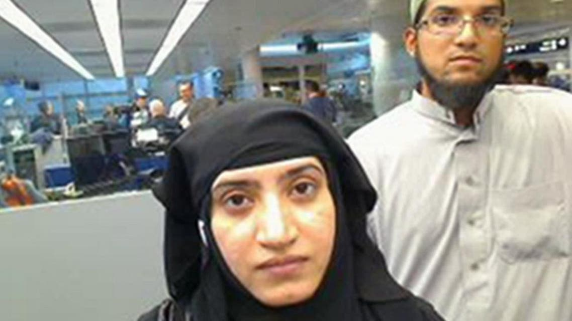 This July 27, 2014 photo provided by U.S. Customs and Border Protection shows Tashfeen Malik, left, and Syed Farook, as they passed through O'Hare International Airport in Chicago. The husband and wife died on Dec. 2, 2015, in a gun battle with authorities several hours after their assault on a gathering of Farook's colleagues in San Bernardino, Calif. (U.S. Customs and Border Protection via AP)