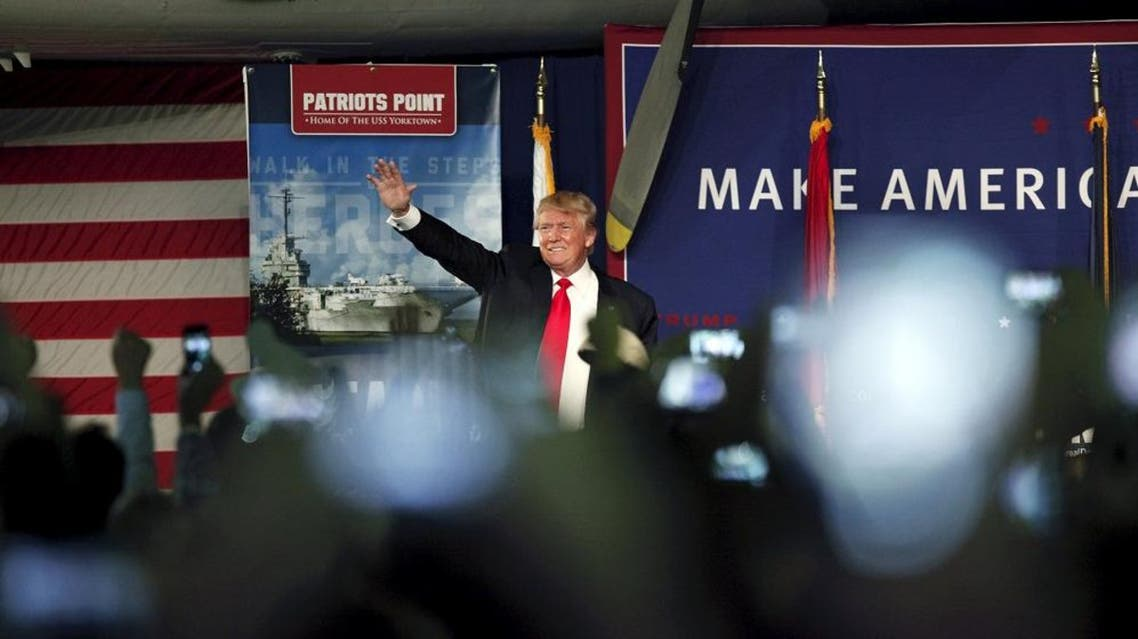 U.S. Republican presidential candidate Donald Trump waves to the crowd at a Pearl Harbor Day rally aboard the USS Yorktown Memorial in Mount Pleasant, South Carolina, December 7, 2015. REUTERS/Randall Hill