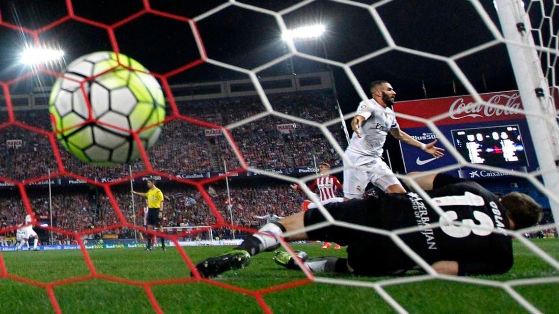 Karim Benzema, center, celebrates after scoring a goal during a Spanish La Liga soccer match on Oct. 4. (AP Photo)