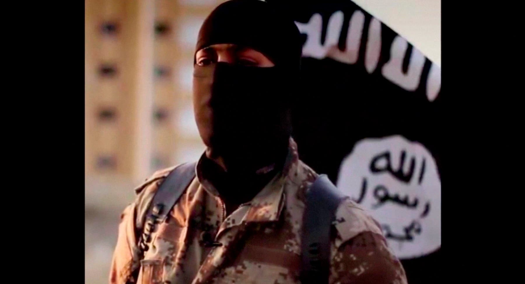 A masked man speaking in what is believed to be a North American accent in a video that ISIS released in September 2014 is pictured in this still frame from video obtained by Reuters October 7, 2014. (Reuters)