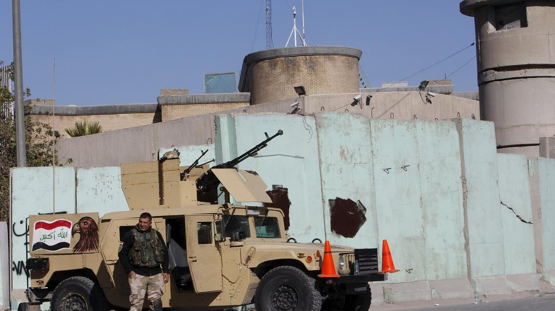 Iraqi security forces stand guard with their military vehicle outside the Turkish embassy in Baghdad. (Reuters)