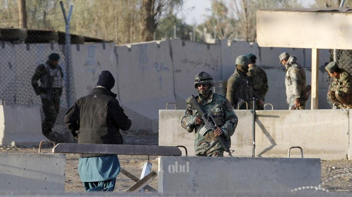 Afghan security forces stand guard at the entrance gate of Kandahar Airport where Taliban stormed on late Tuesday, in Kandahar, Afghanistan December 9, 2015 | Reuters