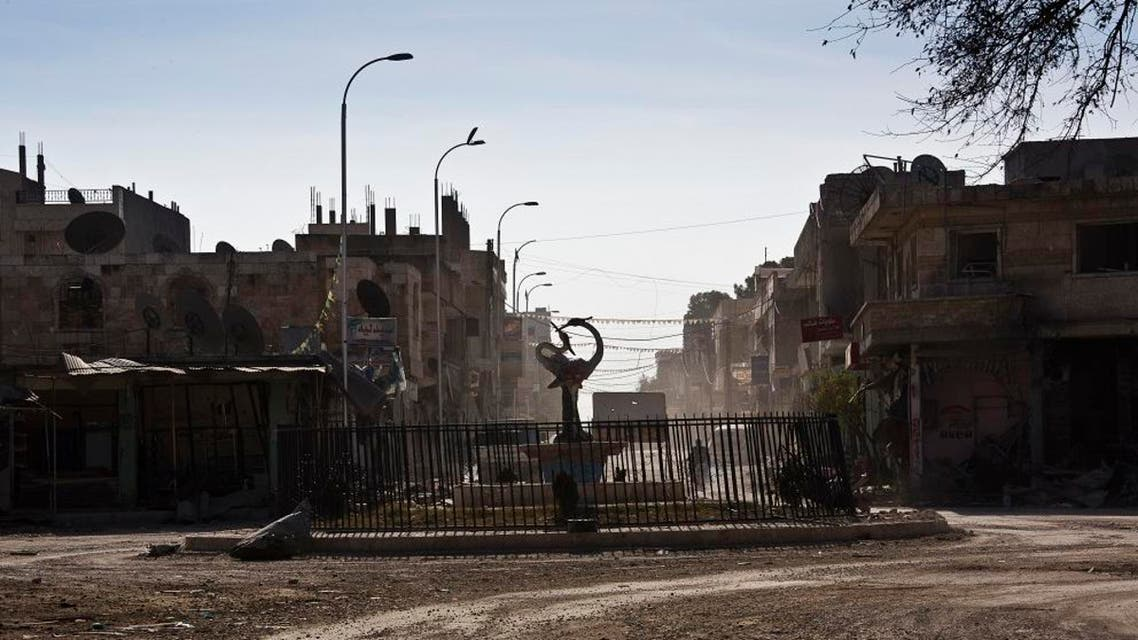 This Nov. 19, 2014 photo shows what remains of Kobani, Syria, after fighting between Islamic State militants and Kurdish fighters and coalition airstrikes. Roundabout circle to the entrance from Kobani to Turkey. (AP Photo/Jake Simkin)