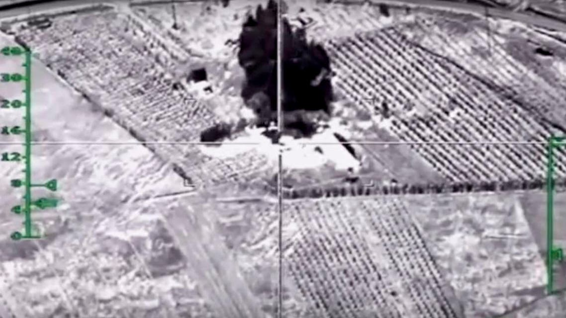 In this photo made from video footage provided by the Russian Defense Ministry on Wednesday, Dec. 9, 2015, a target is hit during an airstrike. Russia has unleashed another barrage of airstrikes against targets in Syria, including the first combat launch of a new cruise missile from a Russian submarine in the Mediterranean Sea, the country's defense minister said Tuesday. (Russian Defense Ministry Press Service via AP)