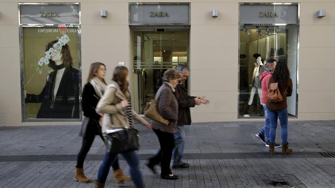 People walk past a Zara store in central Madrid, Spain, December 9, 2015 (Reuters)