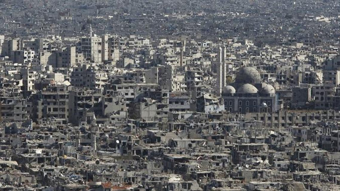A general view shows the Khaled Ibn al-Waleed mosque amid damaged buildings in the old city of Homs, Syria. (Reuters)