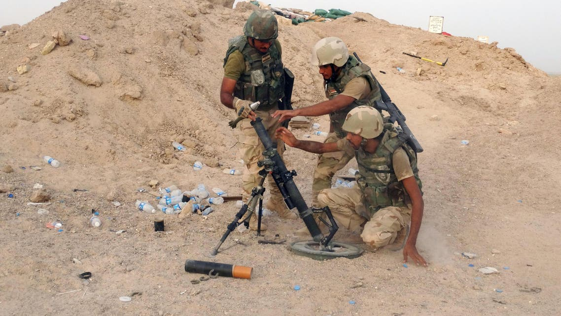 In this Thursday, Aug. 6, 2015 photo, Iraqi Army soldiers prepare to bomb Islamic State group positions at the front line in the eastern suburbs of Ramadi, Anbar province, Iraq.