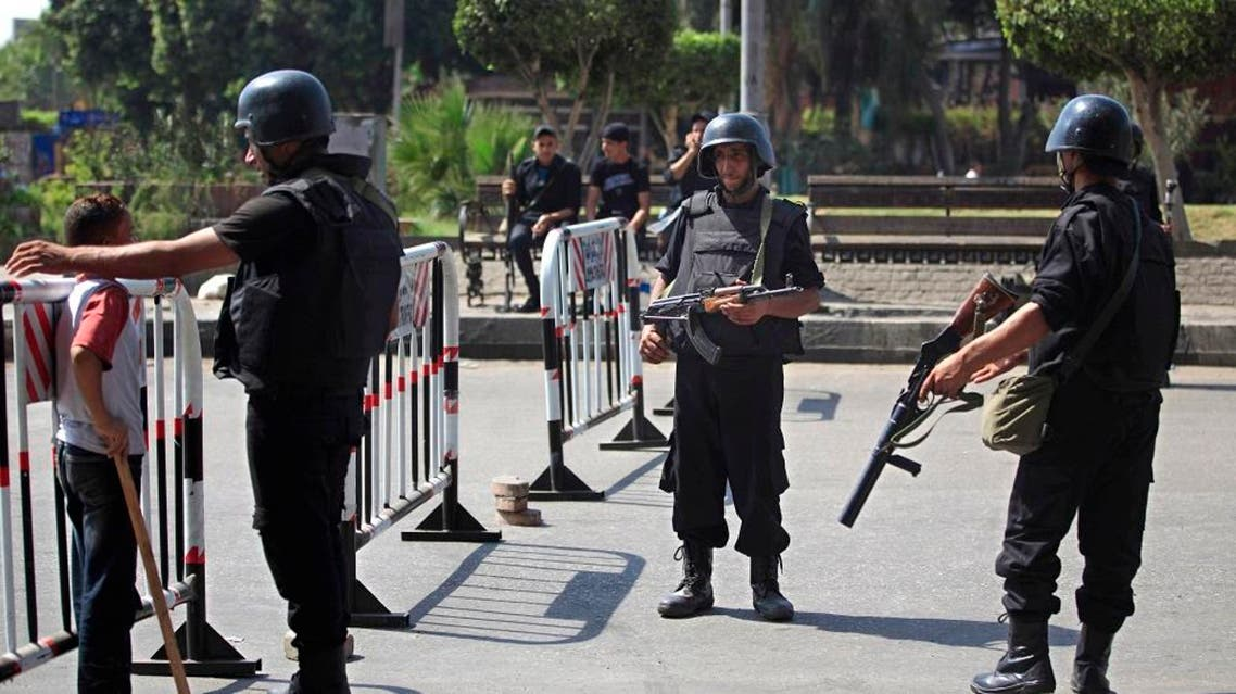 Egyptian police stand guard at an entrance to Sphinx Square in Cairo | AP