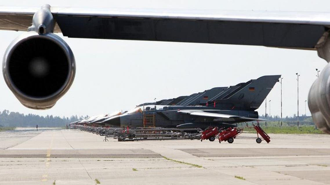 German Tornado fighter jets are a parked on the tarmac of the Italian Airforce airbase in Decimomannu on the Italian Sardinia island, Sunday, March 20, 2011. NATO's top decision-making body is poised to decide whether the alliance will join in the coalition onslaught on Libya. Diplomats said NATO's military planners are due to present on Sunday final action plans to the North Atlantic Council. The body should then decide whether the alliance will join the coalition operation or just provide logistic, intelligence and other support to the nations taking part in the intervention. (AP Photo/Enrico Locci)