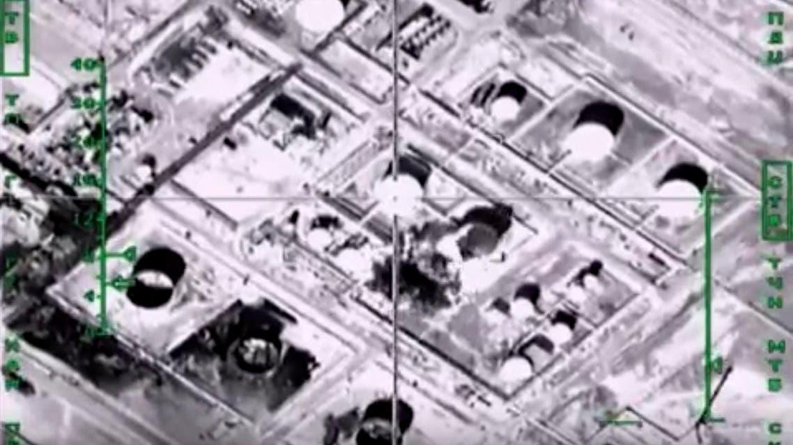 This photo made from the footage taken from Russian Defense Ministry official web site Wednesday, Nov. 18, 2015 shows oil refinement facilities hit during the attack of Russian warplanes in Syria. (AP)