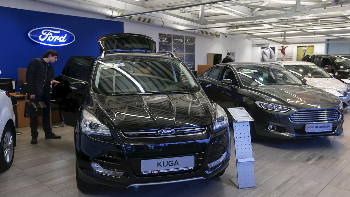 A man checks a Ford car at a showroom in Moscow, Russia, December 4, 2015. (Reuters)