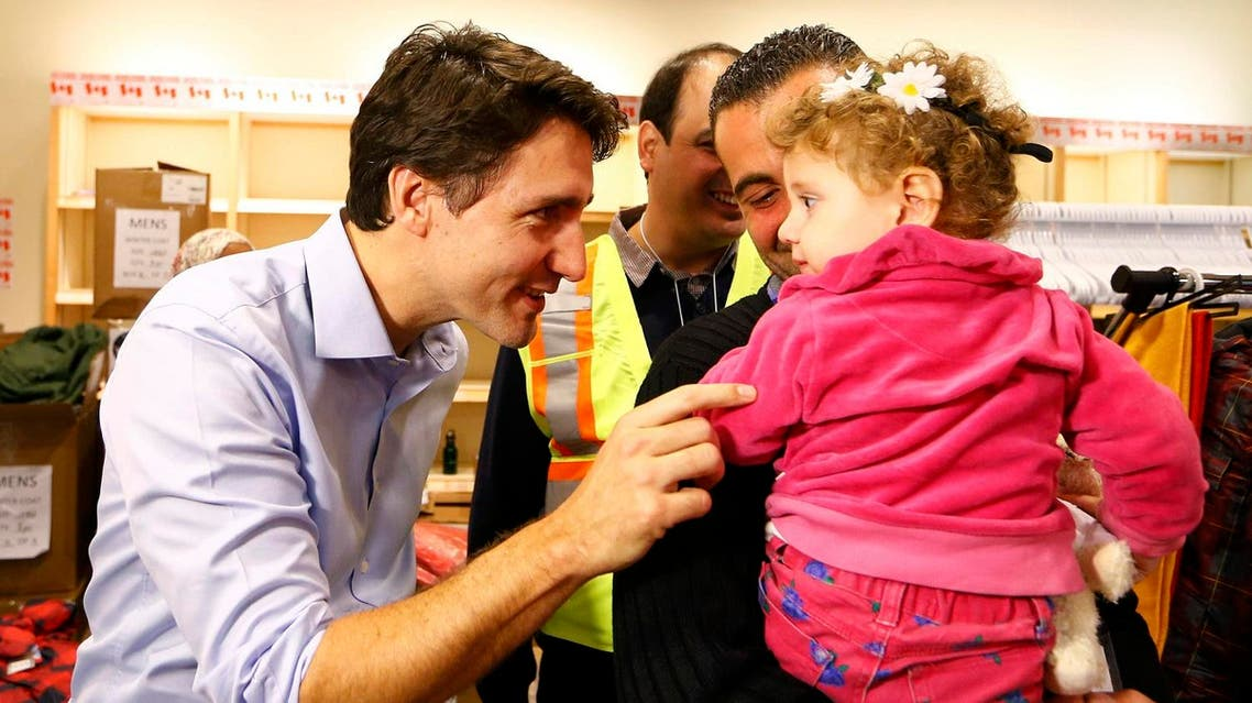 Syrian refugees are greeted by Canada's Prime Minister Justin Trudeau on their arrival from Beirut at the Toronto Pearson International Airport. (Reuters)