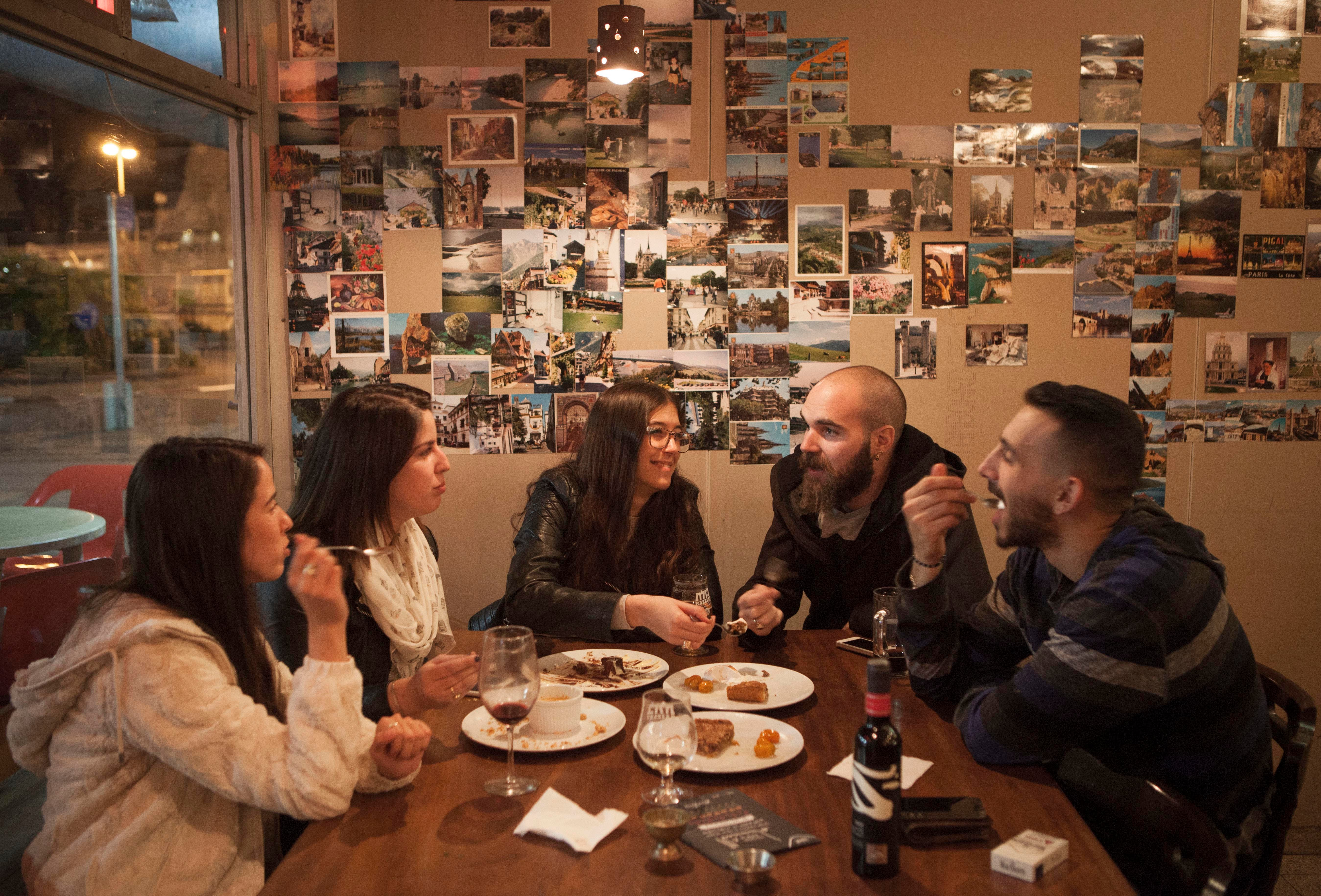 In this photo taken Tuesday, Dec. 8, 2015, Israelis enjoy a meal during an Arab Food Festival in Haifa, Israel. The festival featured about two dozen chefs from around Israel and east Jerusalem. (AP