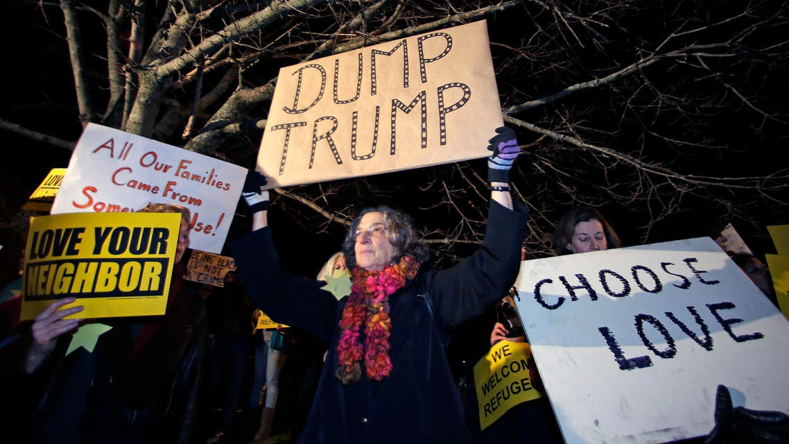 Protestors picket outside a hotel where Republican presidential candidate, Donald Trump will address a regional police union meeting in Portsmouth, N.H., Thursday, Dec. 10, 2015. (AP