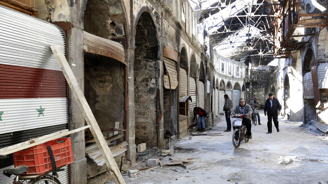 People are seen fixing their damaged shops in the covered market in the old city of Homs, Syria on Tuesday, Dec. 8, 2015. (AP)