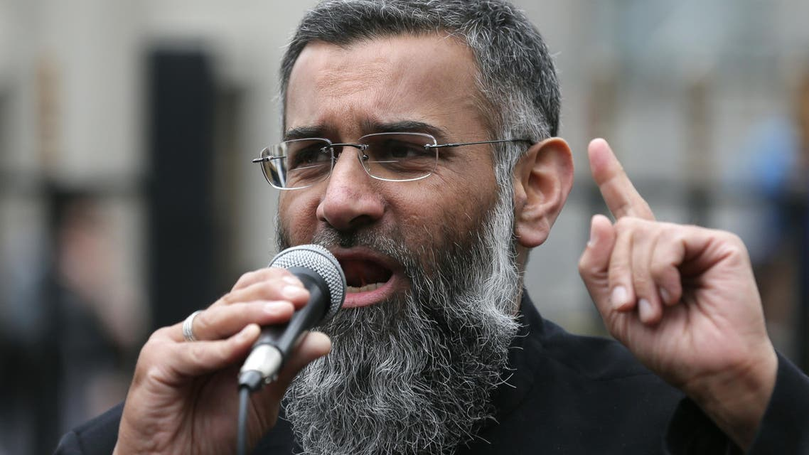 Anjem Choudary, right, a British Muslim social and political activist and spokesman for Islamist group, Islam4UK, speaks following prayers at the Central London Mosque in Regent's Park, London, Friday, April 3, 2015.  (AP)