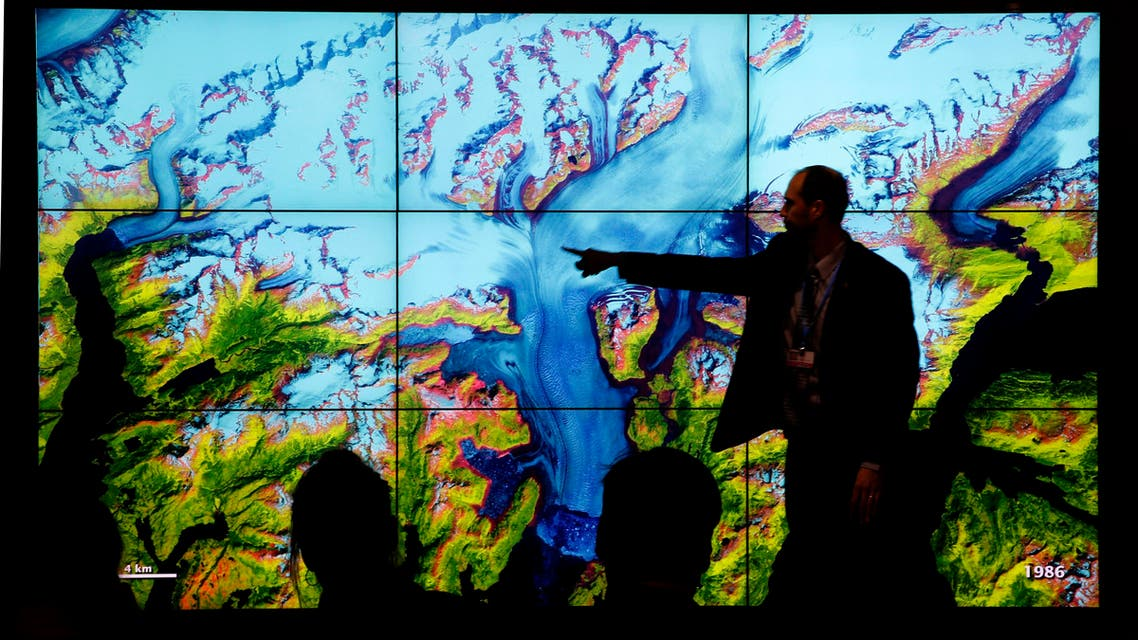 People attend a climate conference at the U.S. pavilion during the COP21, United Nations Climate Change Conference in Le Bourget, north of Paris, Thursday, Dec. 10, 2015.