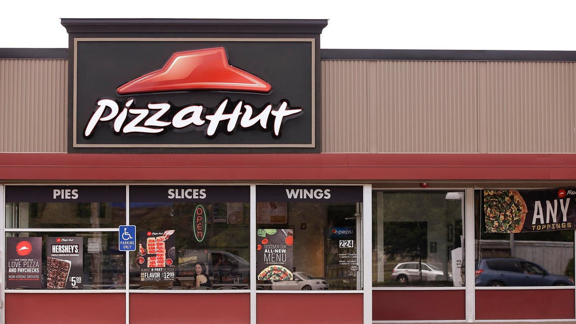 This Thursday, July 9, 2015 photo shows a Pizza Hut restaurant in Taunton, Mass. Yum Brands, parent company of Pizza Hut, Taco Bell and KFC, reports quarterly financial results on Tuesday, July 14, 2015. (AP)