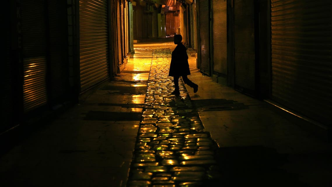 A Turkish boy walks between closed shops at a popular market, in one of the old alley of Hatay city, Turkey, Thursday, Oct. 22, 2015. (AP)