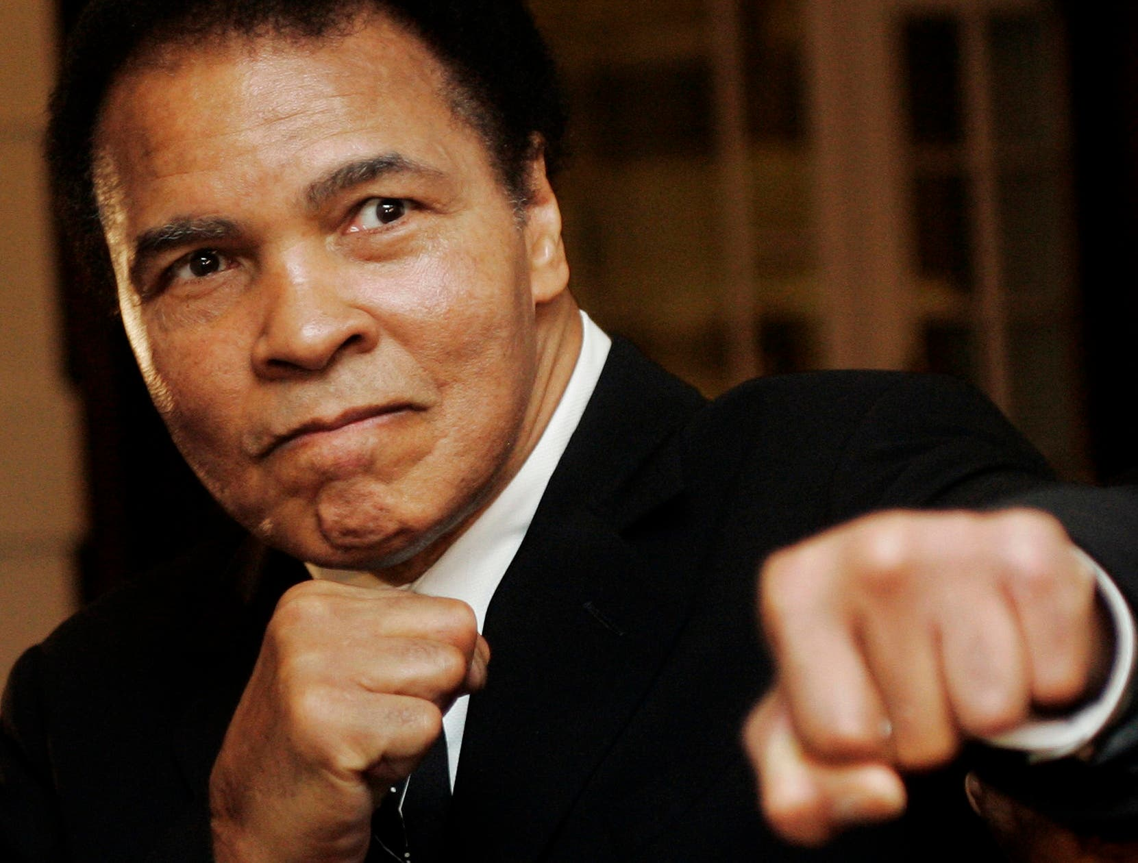 U.S. boxing great Muhammad Ali poses during the Crystal Award ceremony at the World Economic Forum (WEF) in Davos, Switzerland in this January 28, 2006 file photo.