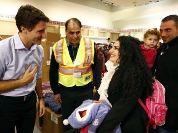 رئيس وزراء كندا باستقبال أول مجموعة من لاجئي سوريا