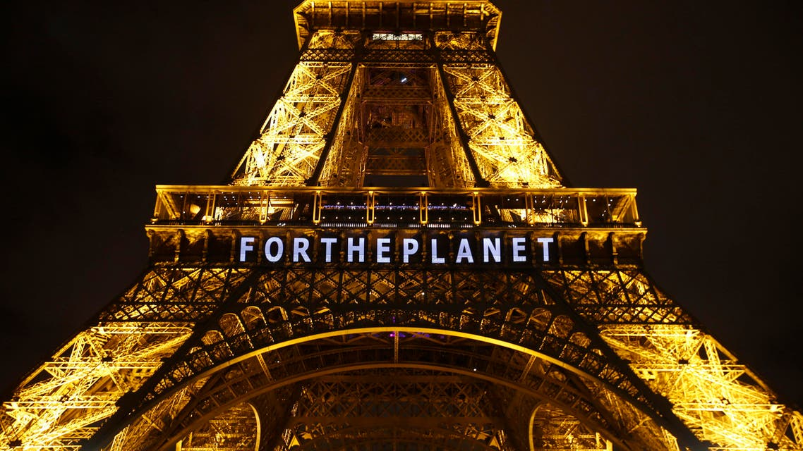 The slogan 'FOR THE PLANET' is projected on the Eiffel Tower as part of the COP21, United Nations Climate Change Conference in Paris, France, Friday, Dec. 11, 2015. (AP)