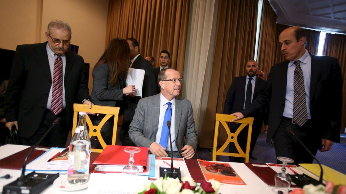 United Nations Special Representative and head of the U.N. Support Mission in Libya Martin Kobler (C) attends a meeting with Libya's two rival governments in Tunis, Tunisia, December 10, 2015.