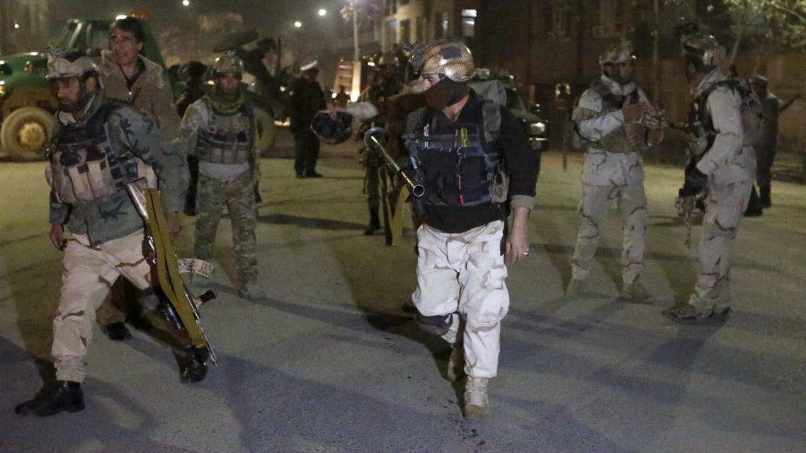 Members of Afghan Crisis Response Unit (CRU) arrive at the site of a Taliban attack in the Afghan capital of Kabul, Afghanistan December 11, 2015.