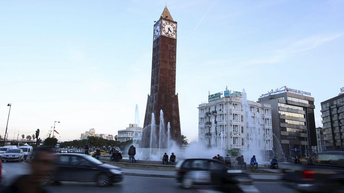Cars pass by the obelisk clock tower at the end of Avenue Habib Bourguiba in Tunis, Tunisia, December 9, 2015. (Reuters)