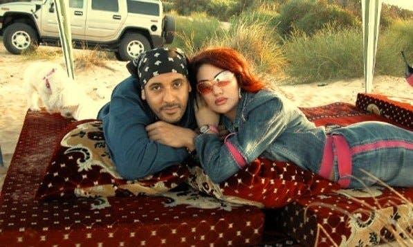 صورة أرشيفية لهنيبعل وزوجته عارضة الأزياء السابقة
