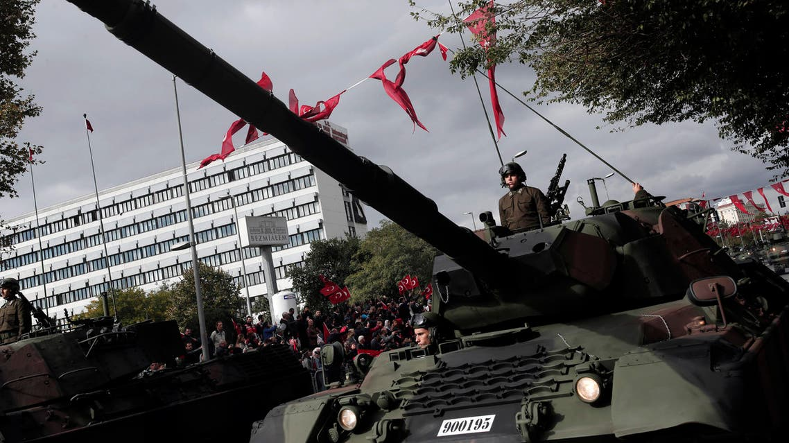 Members of Turkish armed forces atop tanks drive past during a parade for the anniversary celebrations of the Turkish Republic in Istanbul, Thursday, Oct. 29, 2015. (AP