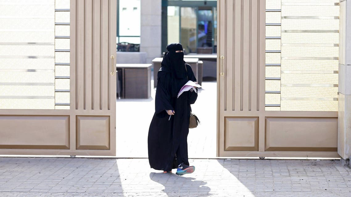 A woman leaves a polling station after casting her vote during municipal elections, in Riyadh, Saudi Arabia December 12, 2015. REUTERS