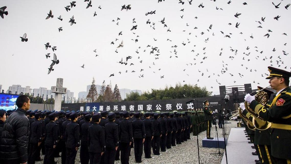 Pigeons fly as people attend a ceremony to mark the second national memorial day for the Nanjing Massacre, at the Nanjing Massacre Museum in Nanjing, Jiangsu province, China. (Reuters)