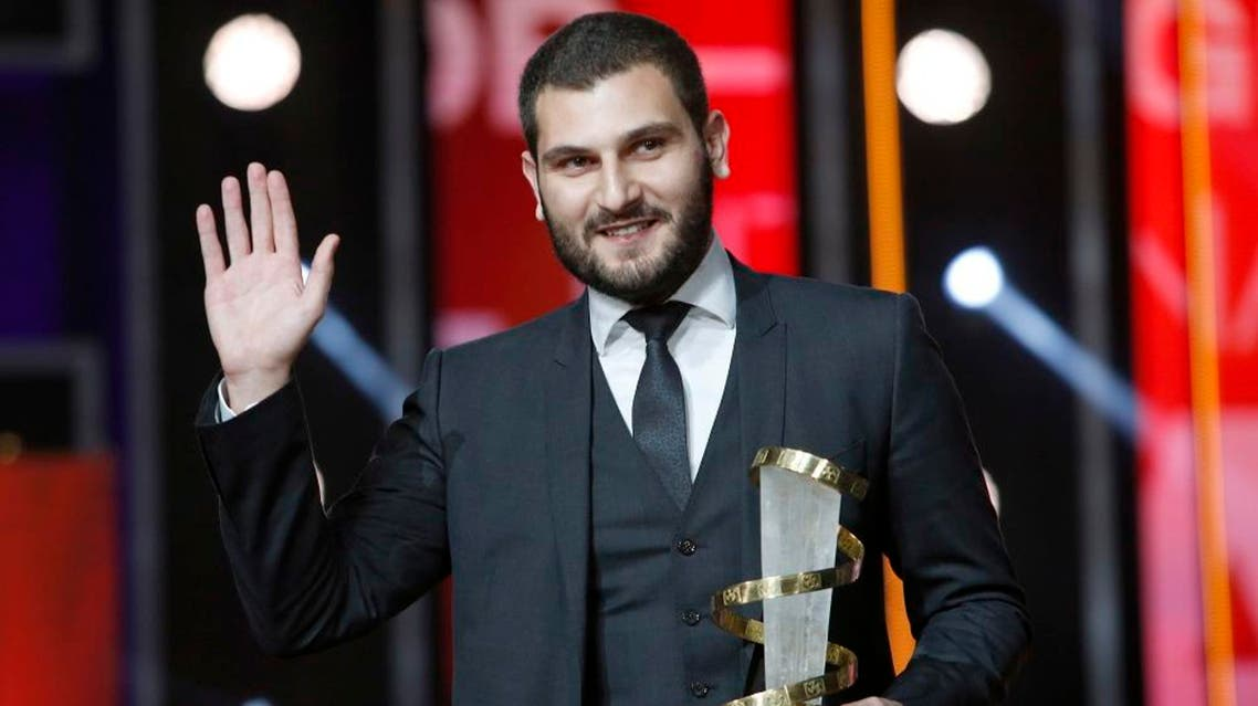 "Director Mir-Jean Bou Chaaya poses for photographers after winning the Golden Star prize for the film "" Very Big Shot "" during the closing ceremony of the the 15th Marrakech International Film in Marrakech, Saturday, Dec. 12, 2015. (AP)"